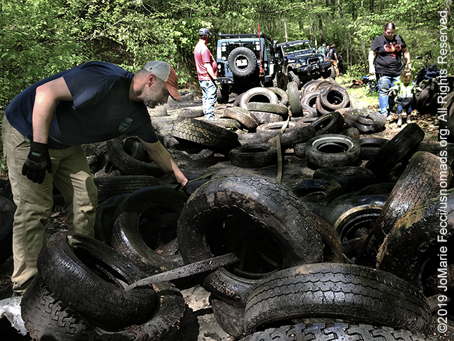 PA_May2019_0511_TrailCleanup_tirepilewithmikeandjeepsinback_IMG_6512_650w