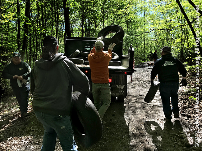 PA_May2019_0511_TrailCleanup_tossingtiresintotruckback_IMG_6427_650w