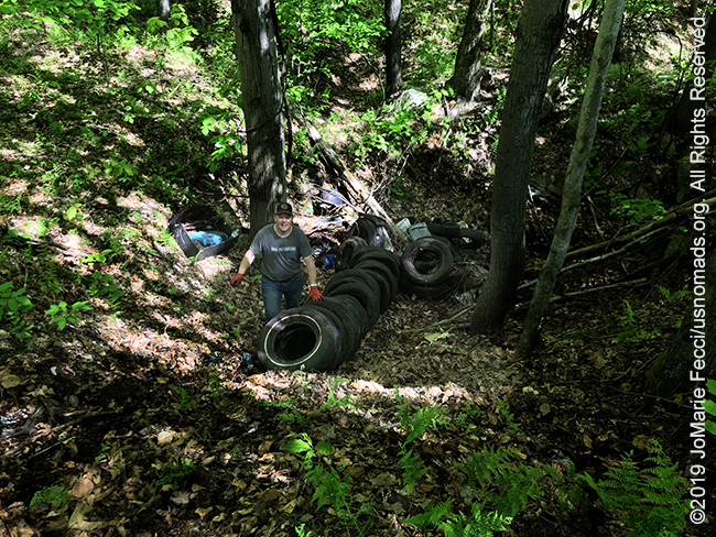PA_May2019_0511_TrailCleanup_volunteerwithpileoftires_IMG_6443_650w