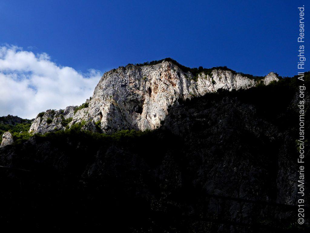 Serbia_Aug2019_Day07_roadtrip-gorge-cliffwallbeyoundhilltop_DSCN6534_1200w