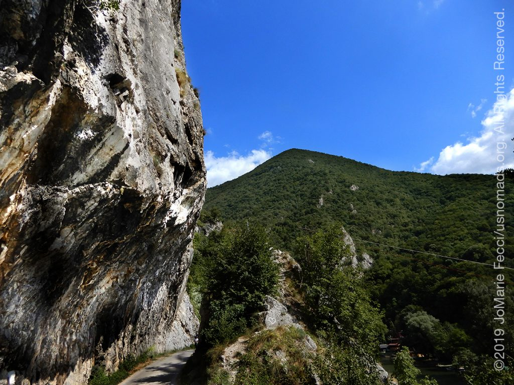 Serbia_Aug2019_Day07_roadtrip-gorge-cliffwalldistantmountain_DSCN6542_1200w