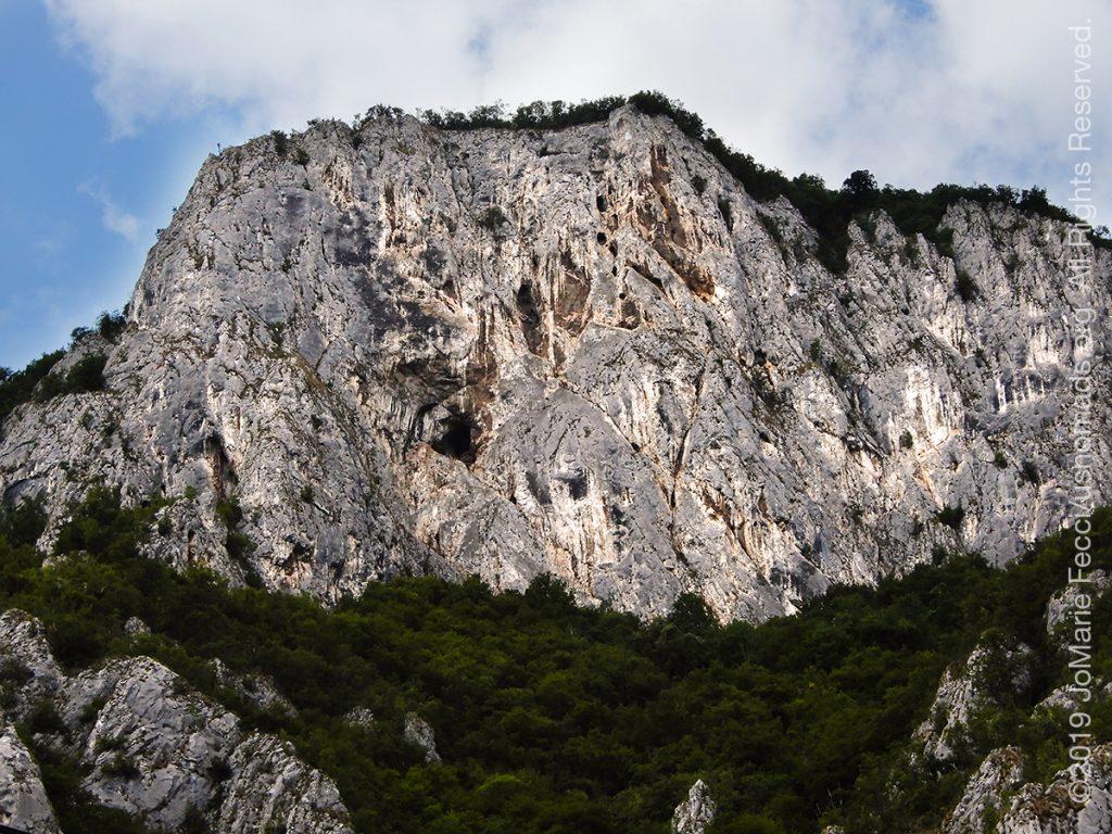 Serbia_Aug2019_Day07_roadtrip-gorge-cliffwallwithcavedetail_DSCN6516_1200w