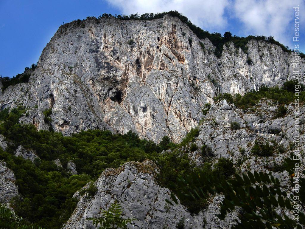 Serbia_Aug2019_Day07_roadtrip-gorge-rockwallswithcavedistant_DSCN6528_1200w