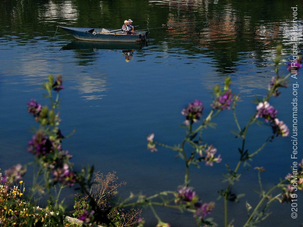 Serbia_Aug2019_Day08_roadtrip-visegrad_twomeninboatthruflowers_DSCN6645_1200w