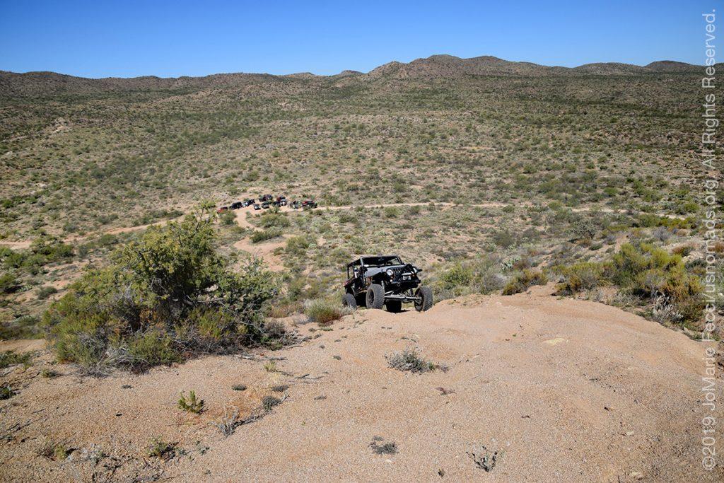 AZ_LONtrip_OCT2019_1005-Day03-TucsonRR_Jeepcominguphillgroupatbottomwideshot_DSC_0436_1200w