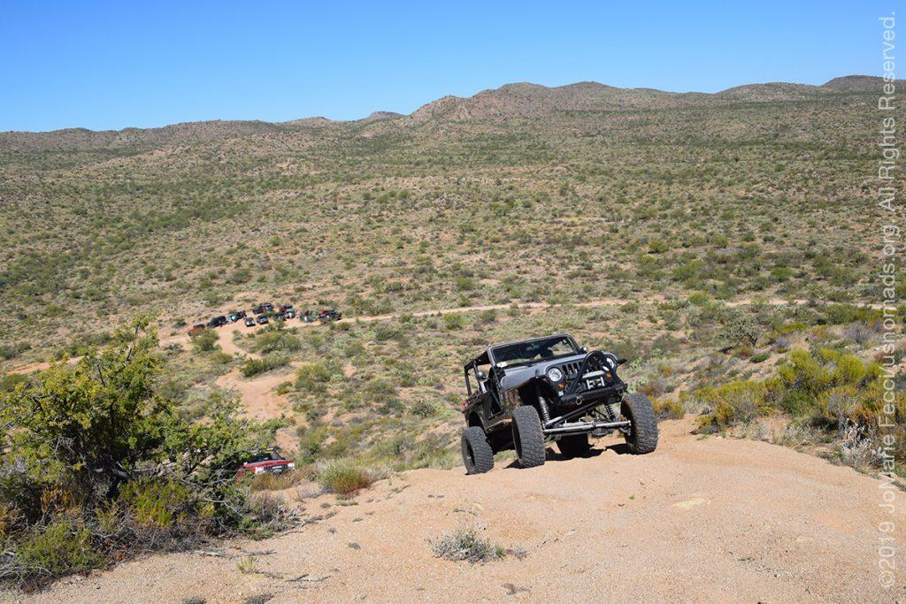 AZ_LONtrip_OCT2019_1005-Day03-TucsonRR_onejeepcomnguphilllandscapebelow_DSC_0443_1200w